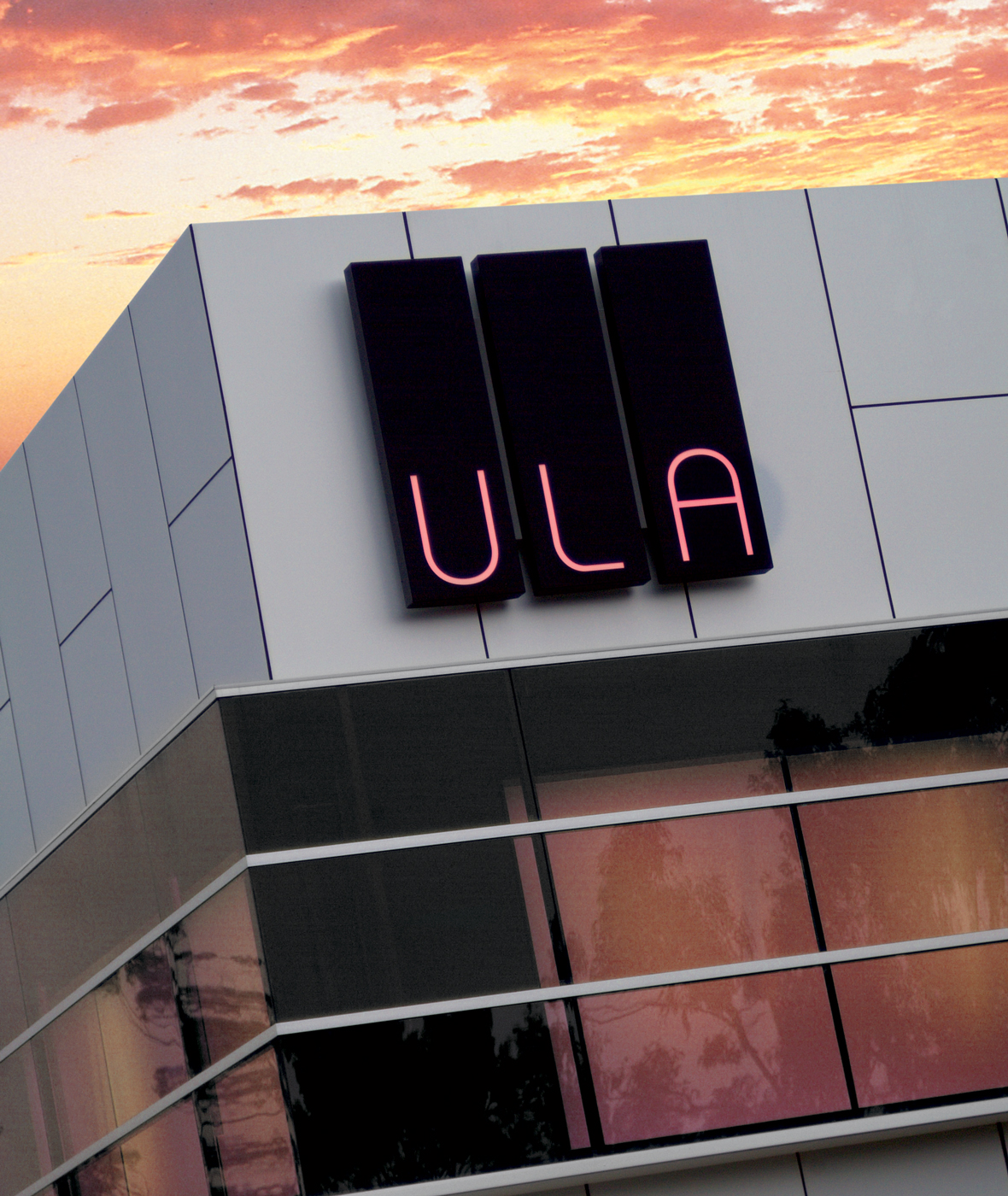 ULA Illuminated LED Building Sign at Sunset
